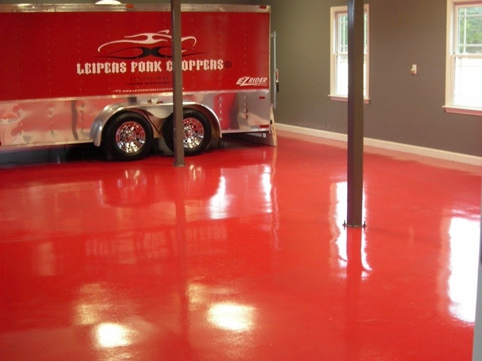 Three truck warehouse with red glossy floors