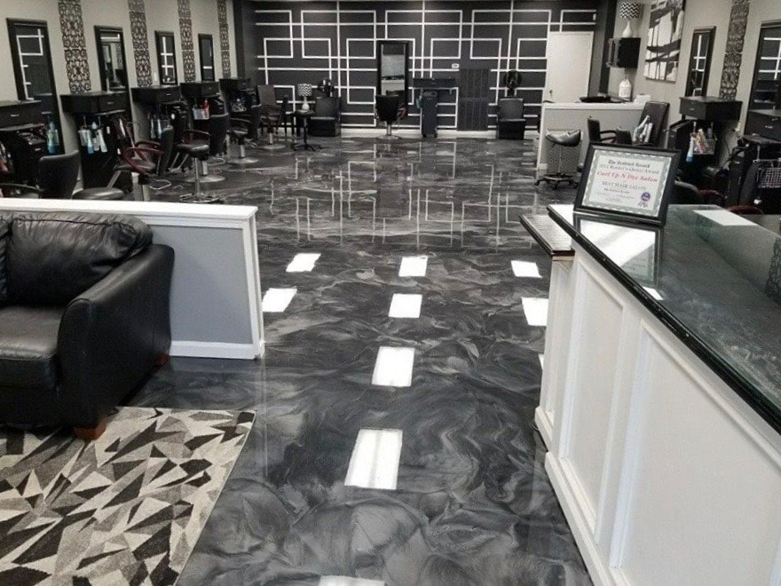 Glossy concrete flooring of hair salon