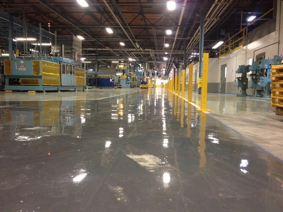 Large manufacturing warehouse with concrete flooring